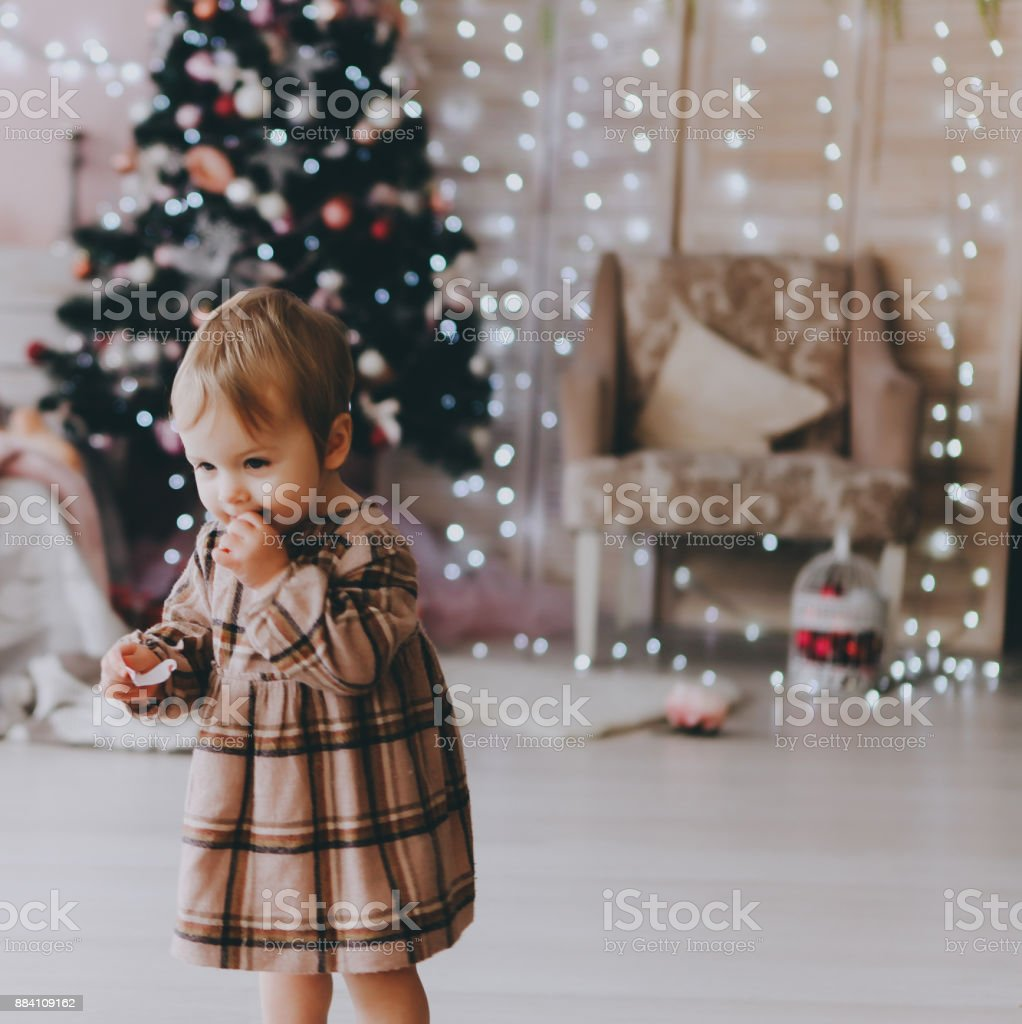Little girl in a Christmas interior. stock photo