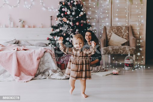 istock Little girl in a Christmas interior. 889090278