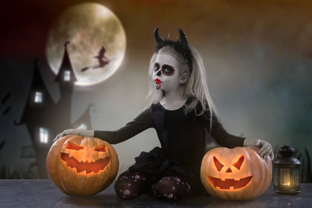 Little girl in a costume of witch posing with pumpkins over fairy picture id1053104024?b=1&k=6&m=1053104024&s=612x612&w=0&h=znjclskyxyt8mtld0apnraccawgf8p1tjokgg6vyub8=