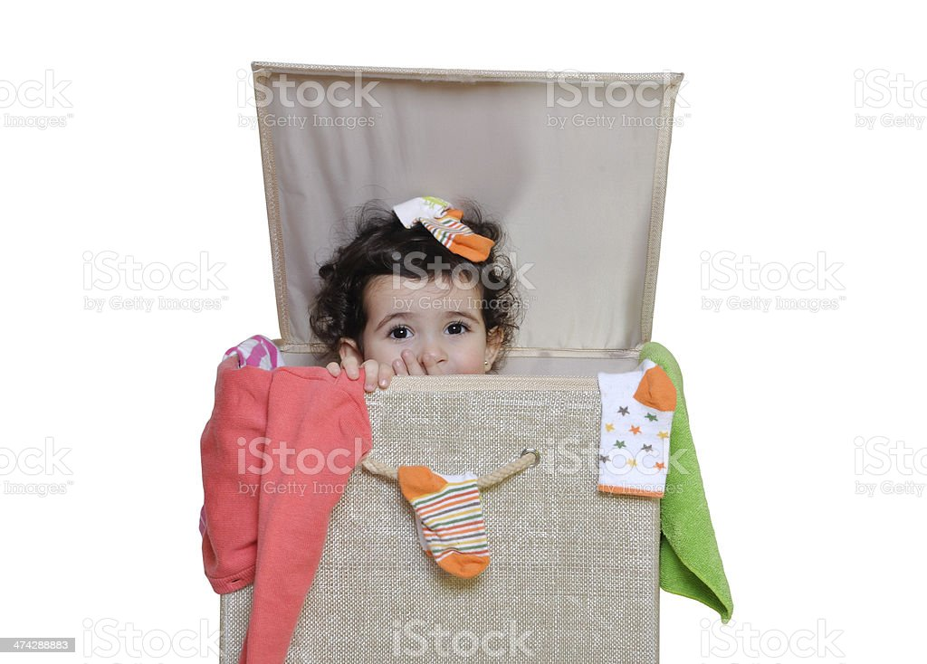 Little girl in a Laundry Basket stock photo
