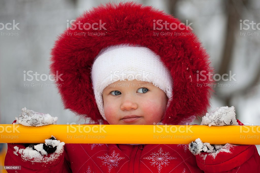 Little girl in a red jumpsuit royalty-free stock photo