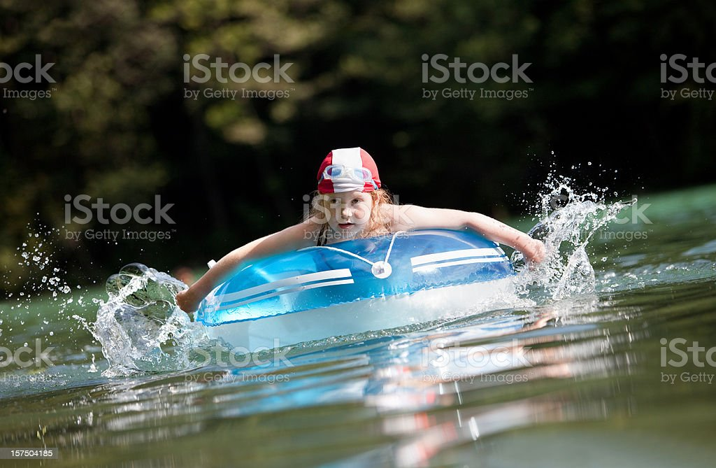Little girl in a rubber dinghy royalty-free stock photo
