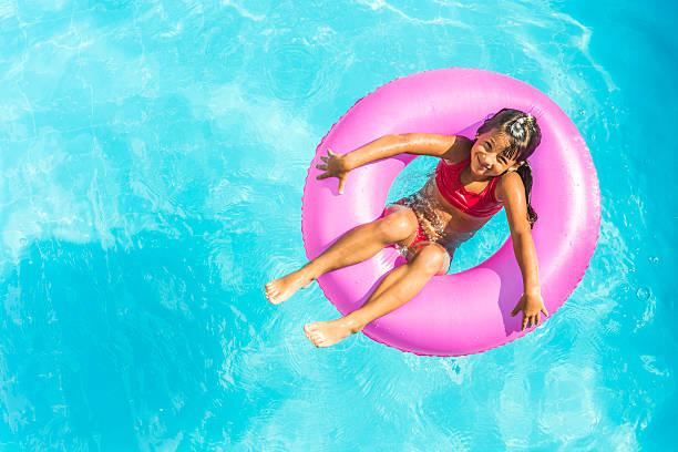 little girl in a swimming pool - inflatable ring bildbanksfoton och bilder