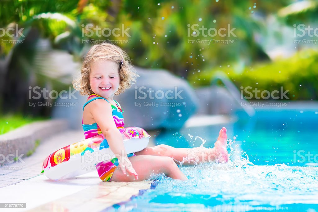 Little girl in a swimming pool stock photo