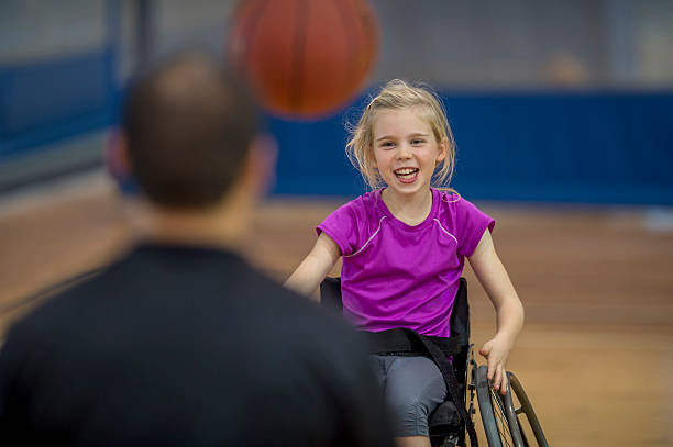 little girl in a wheelchair - wheelchair sports stock photos and pictures