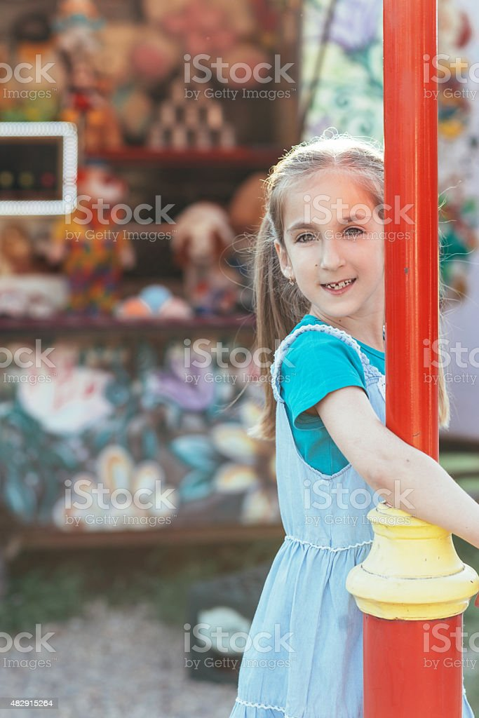 Little girl in amusment park stock photo