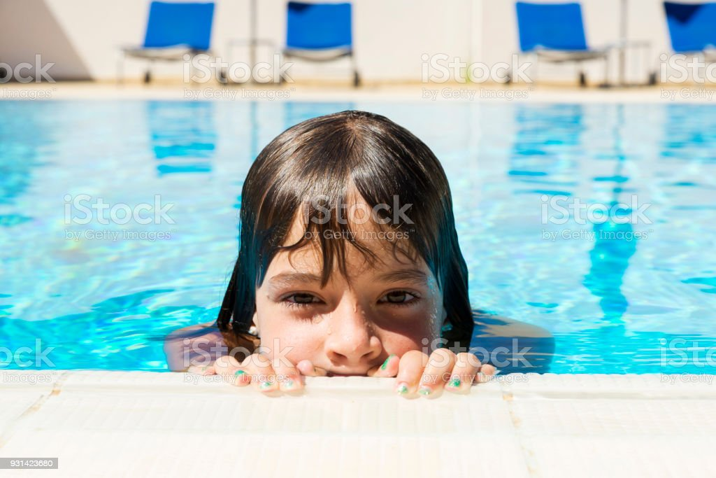 0548fc2335 Baby - Human Age, Caucasian Ethnicity, Hand, Human Face, Human Hand. Little  girl in an outdoor pool ...