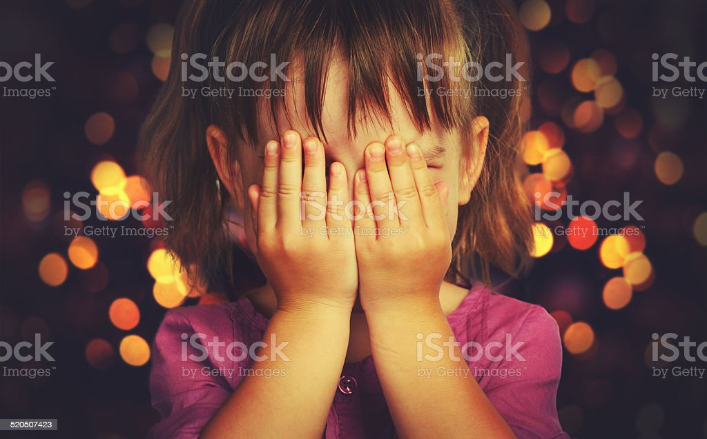 little girl  in anticipation of Christmas miracle and a gift stock photo