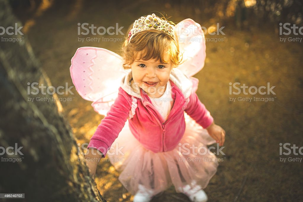 Little girl in beautiful costume with wings stock photo