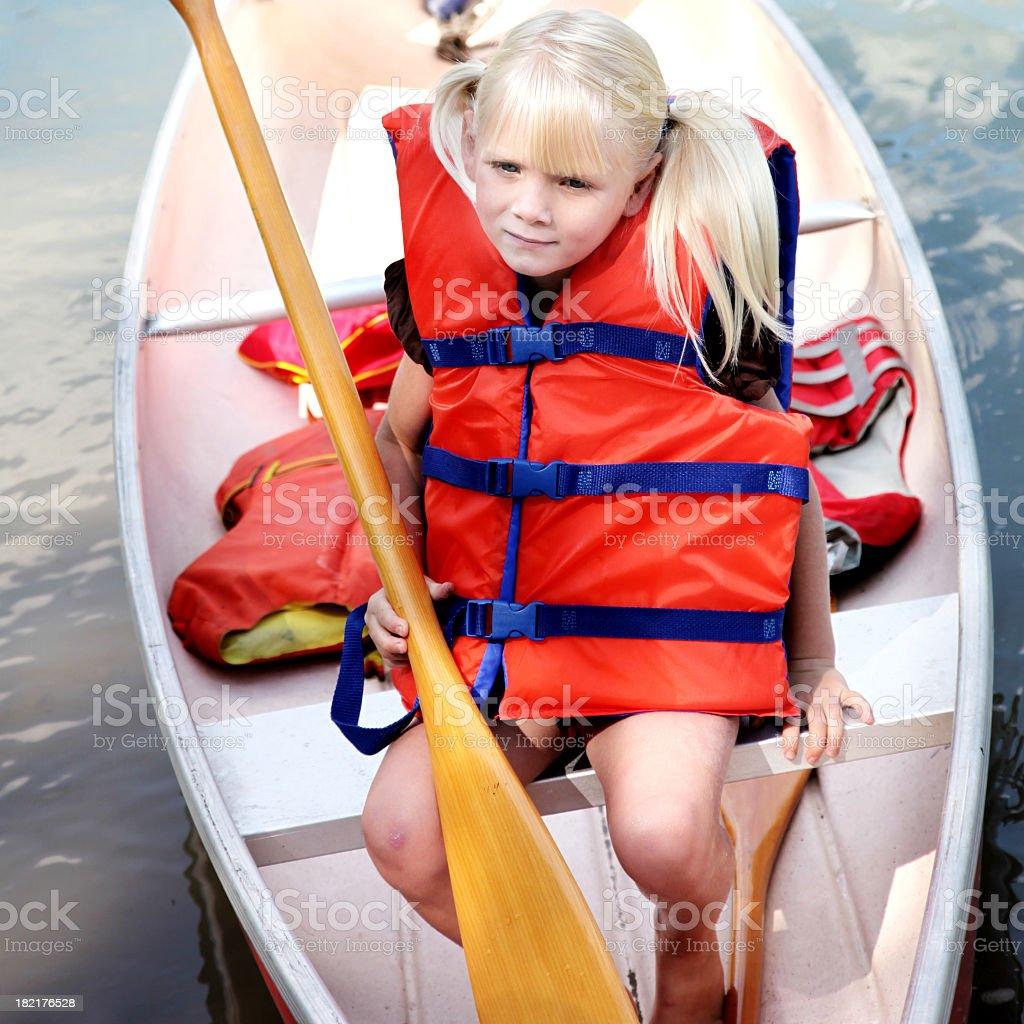 Little girl in canoe royalty-free stock photo