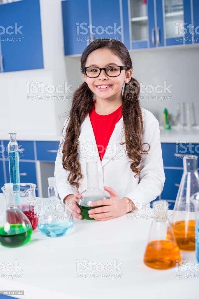 Little girl in chemical laboratory zbiór zdjęć royalty-free