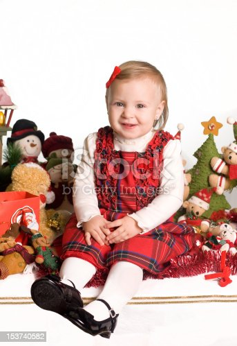 istock Little girl in christmas atmosphere 153740582