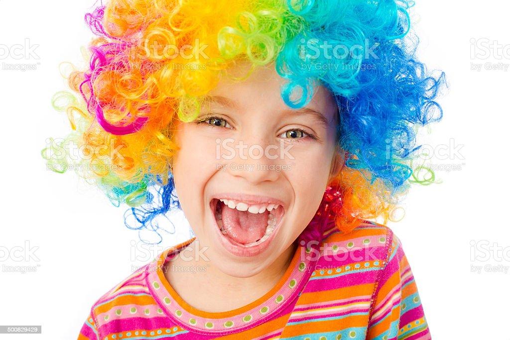 little girl in clown wig stock photo