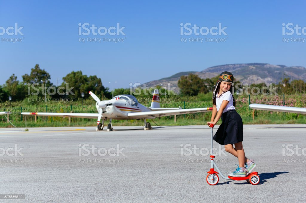 little girl in dream world  at the airport stock photo