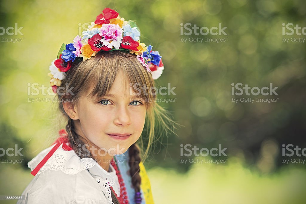 Little girl in folk costume (Krakowianka) stock photo