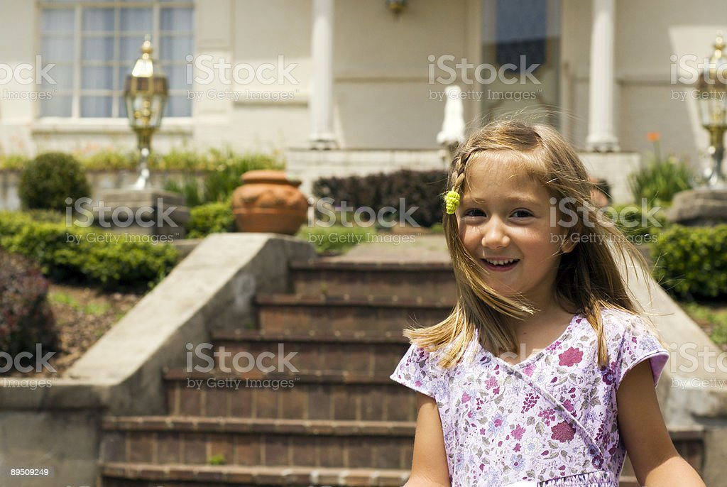 Little Girl in front of house royalty-free stock photo