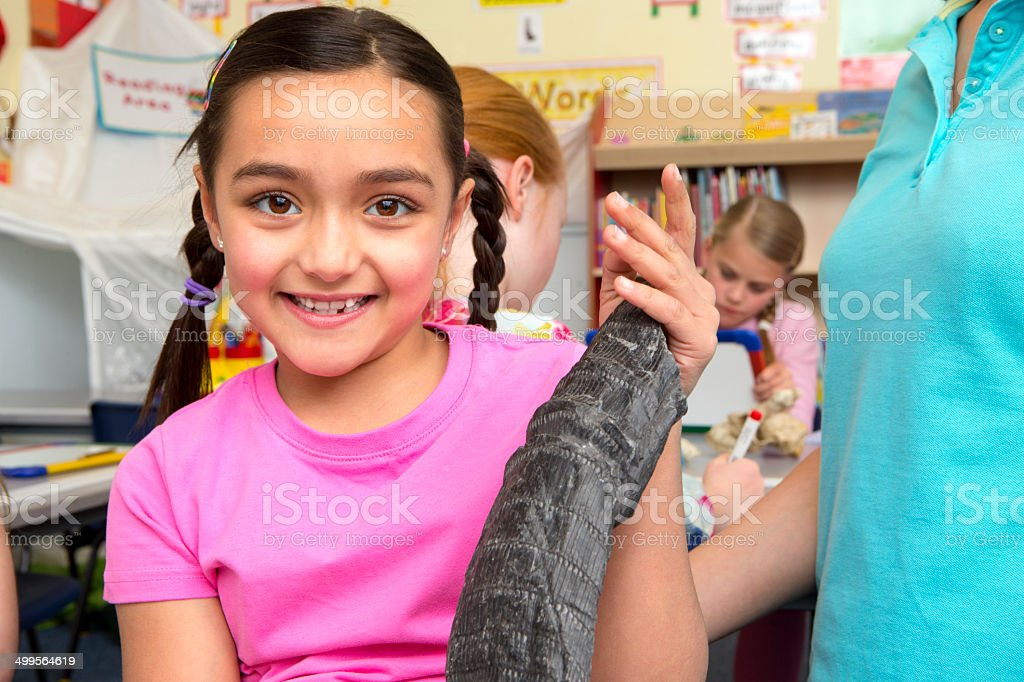Little Girl in Geology Lesson royalty-free stock photo