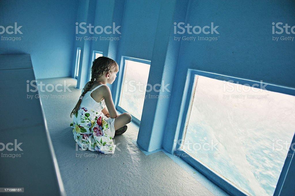 Little girl in glass bottom boat stock photo