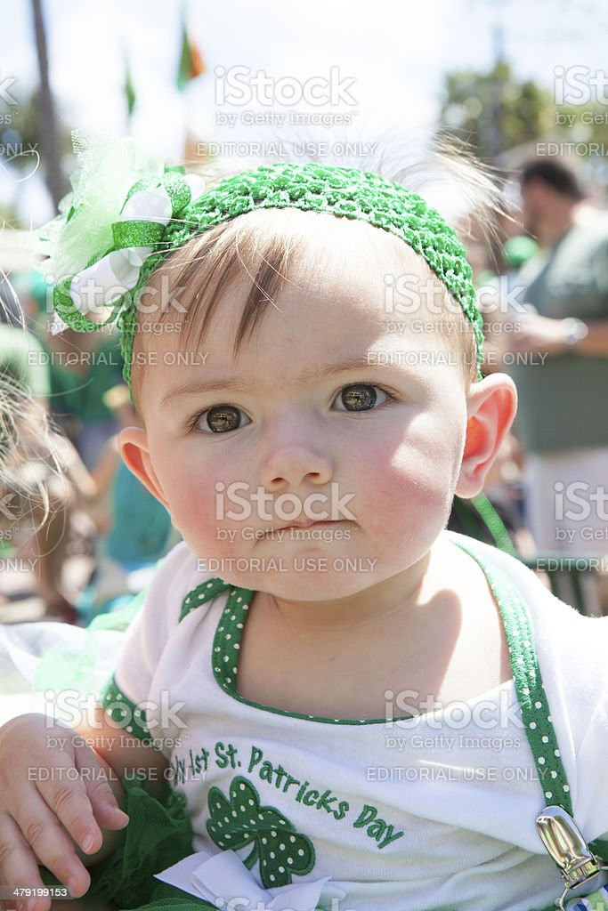 Little girl in green to watch St. Patrick's Day parade stock photo