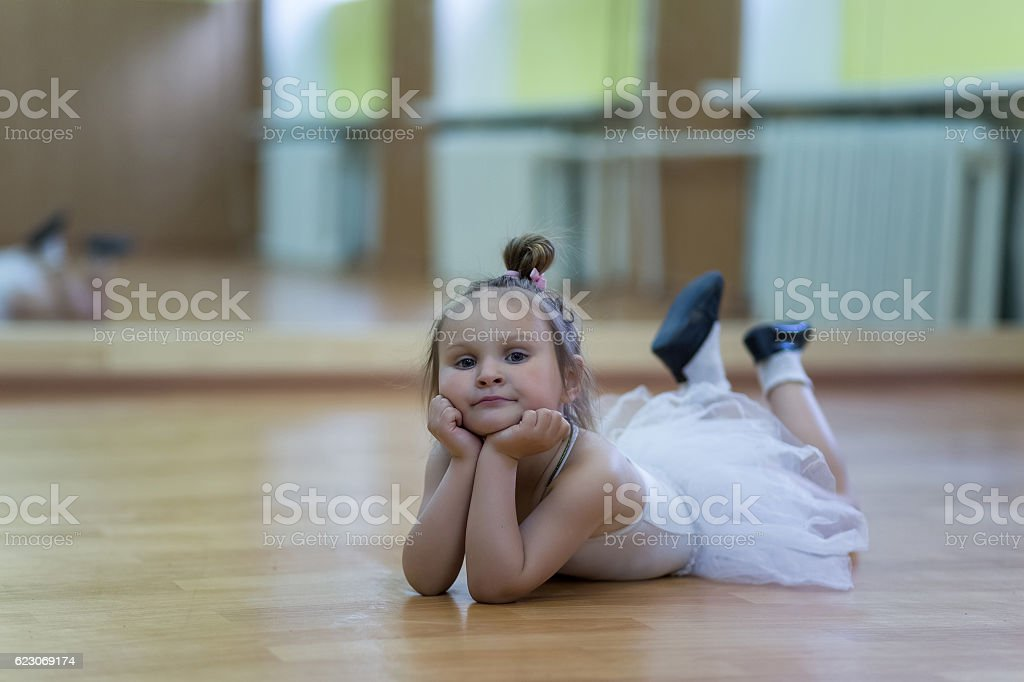 Little girl in gymnastic leotard stock photo