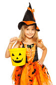 istock Little girl in Halloween witch dress 513647183
