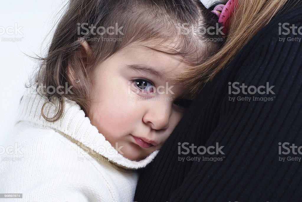 little girl in her mother's lap royalty-free stock photo