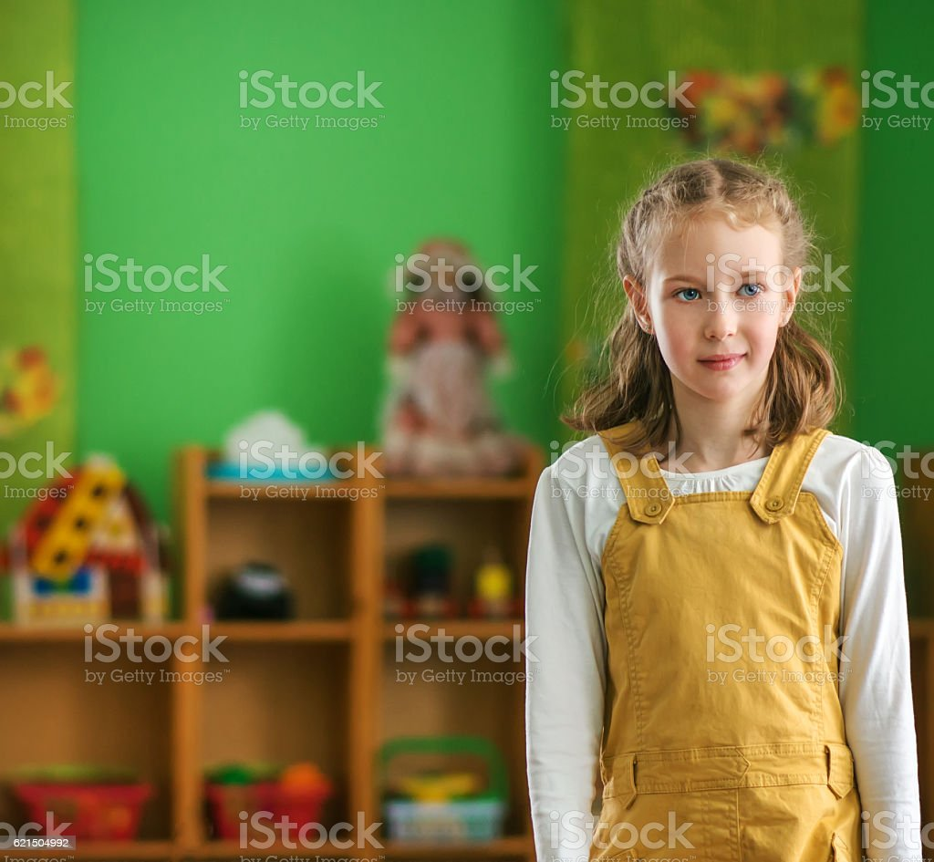 Little girl in kindergarten. Place for your text. photo libre de droits