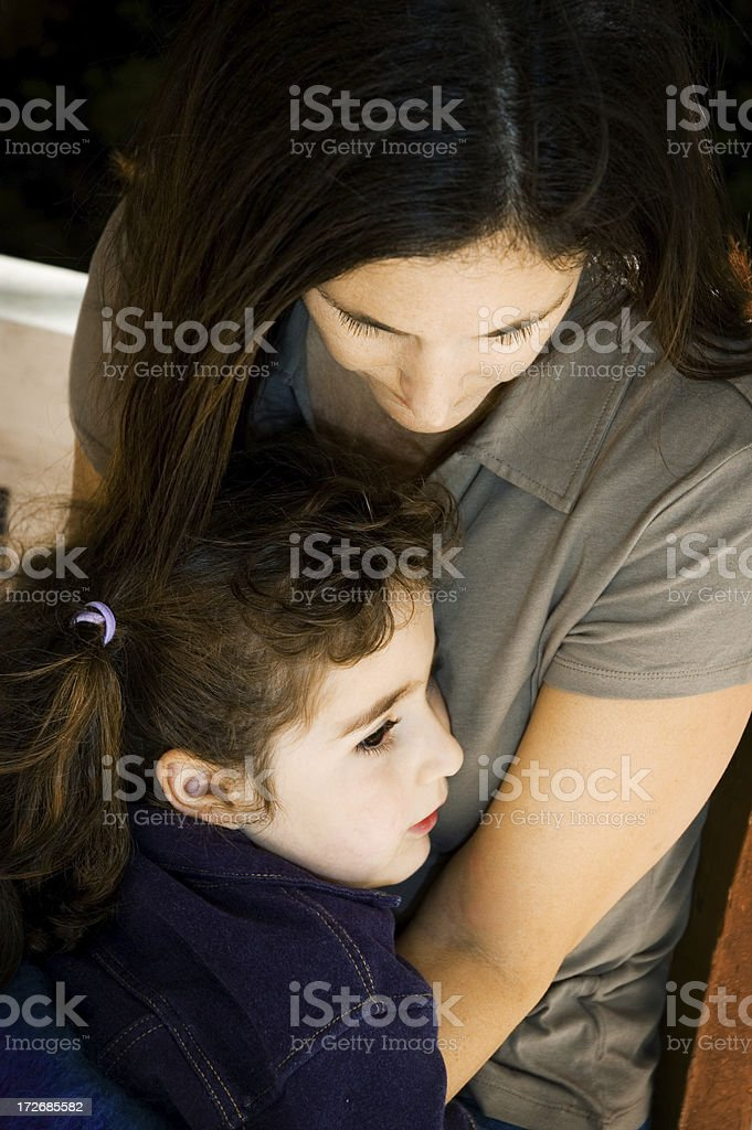 Little Girl in Mother's Arms royalty-free stock photo