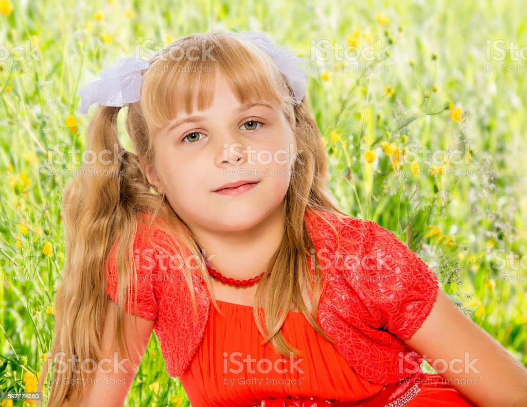 Little girl in orange dress royalty-free stock photo