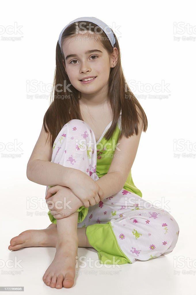 little girl in pyjamas stock photo