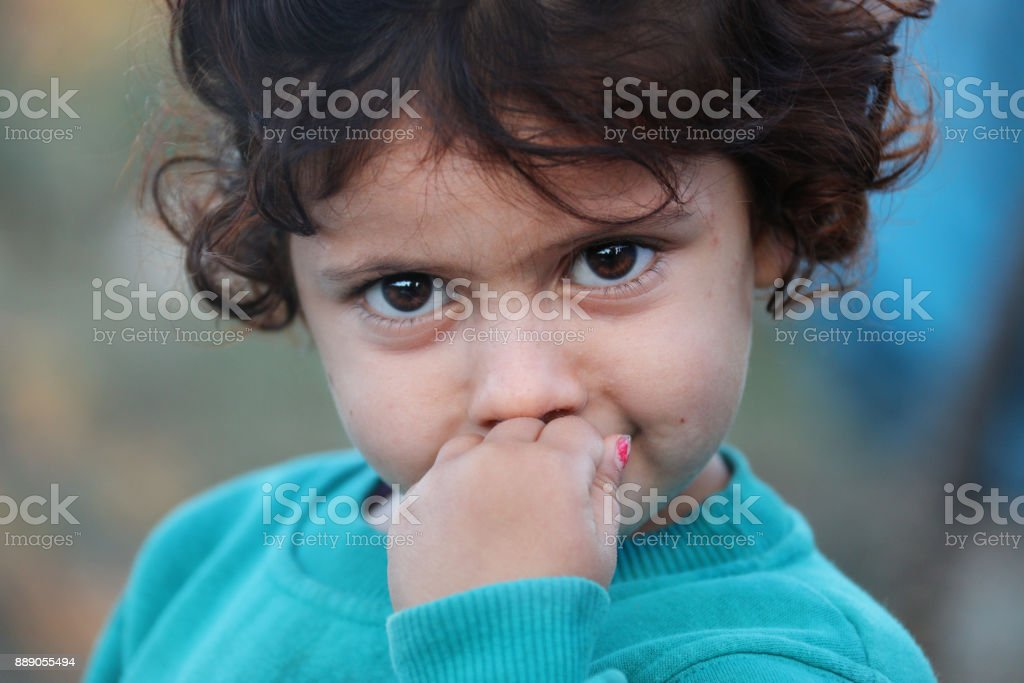 little girl in refugee camp stock photo