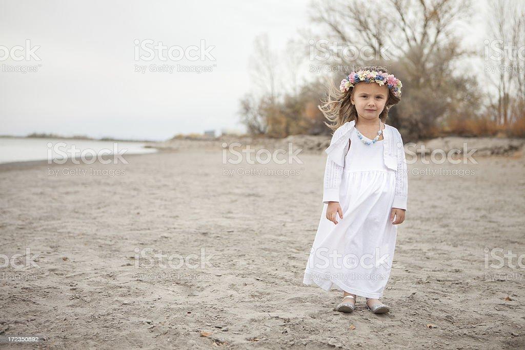 Little Girl in Rural Autumn Scene on Beach royalty-free stock photo