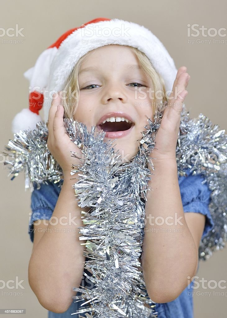 Little girl in Santa Hat laughing stock photo