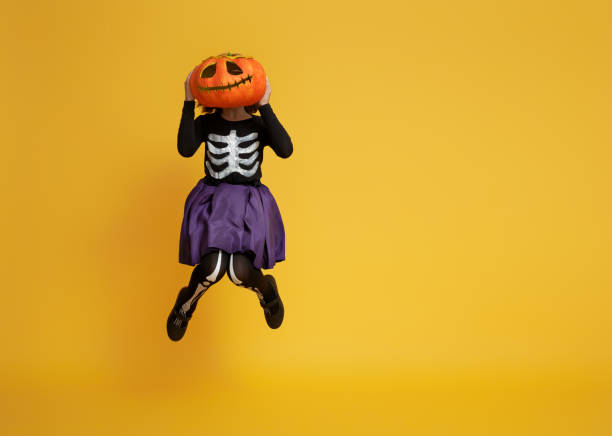 little girl in skeleton costume stock photo