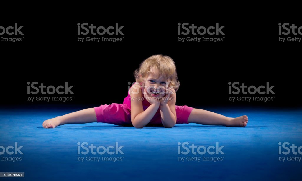 Little girl in sports hall stock photo