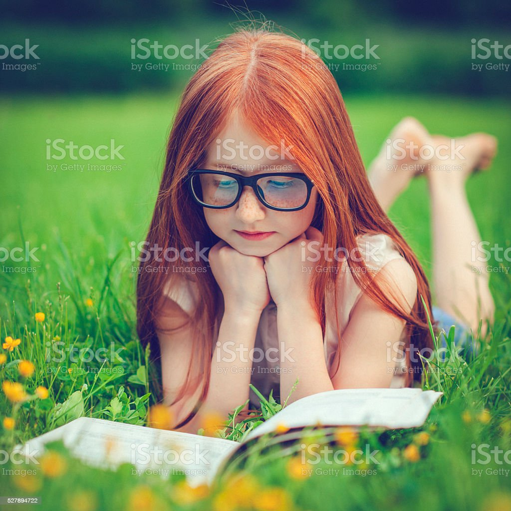 Little girl in summer stock photo