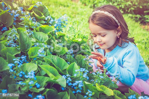 Happy child and flowers