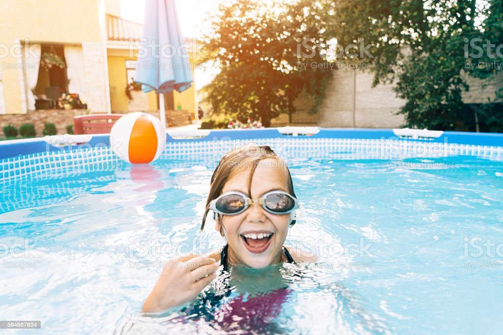 Little girl in swimming pool stock photo