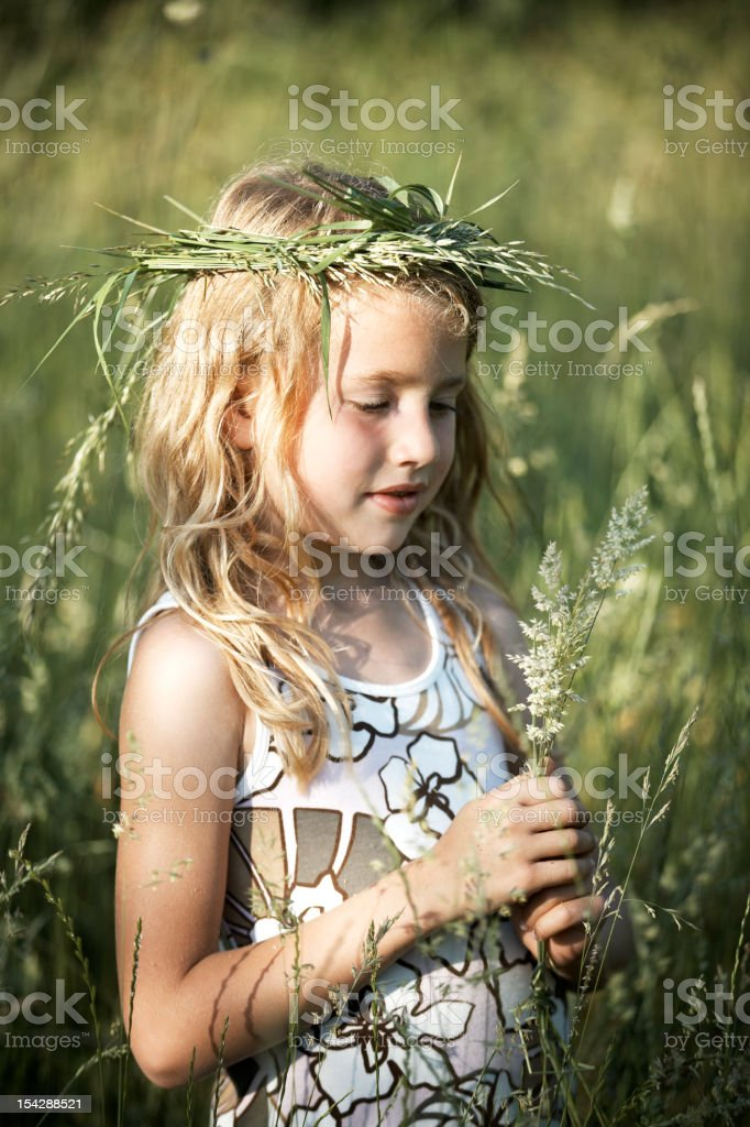 Little Girl in Tall Grass Field royalty-free stock photo