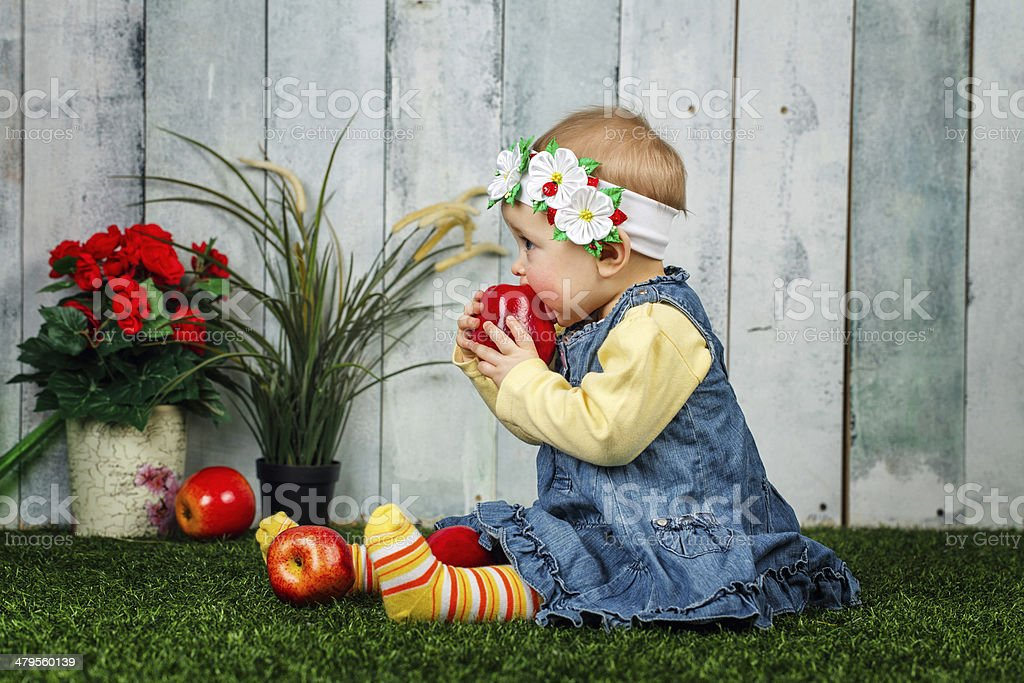 Little girl in the backyard stock photo