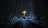 istock Little girl in the dark forest 533382297