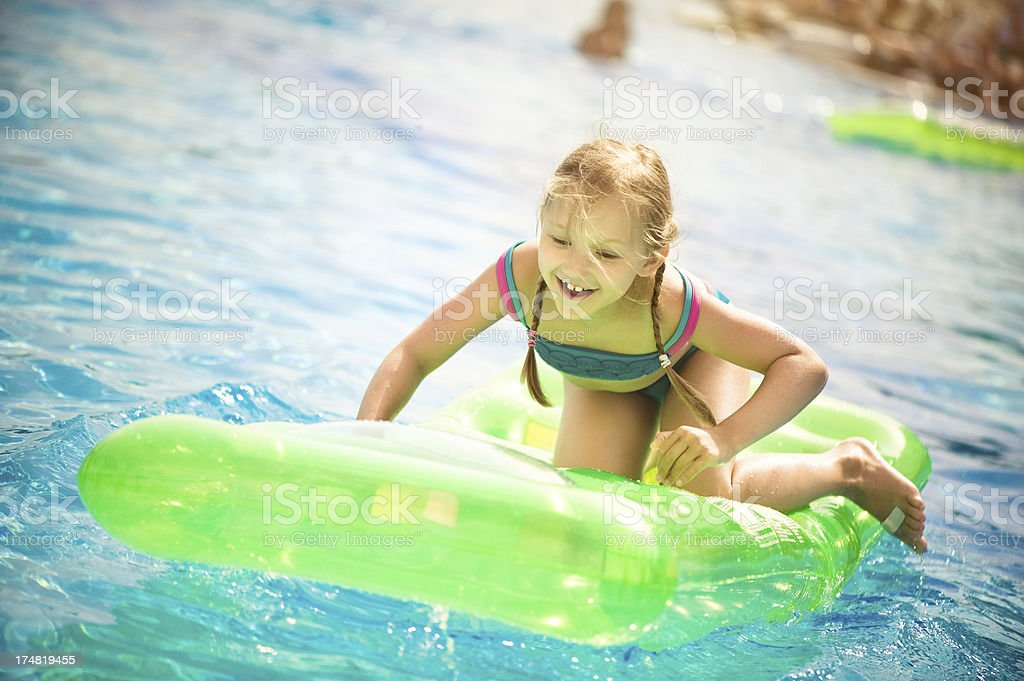 Little girl in the pool royalty-free stock photo
