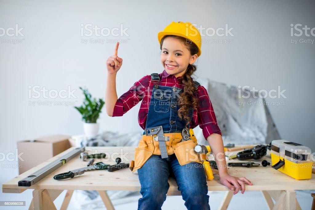 Little girl in tool belt stock photo