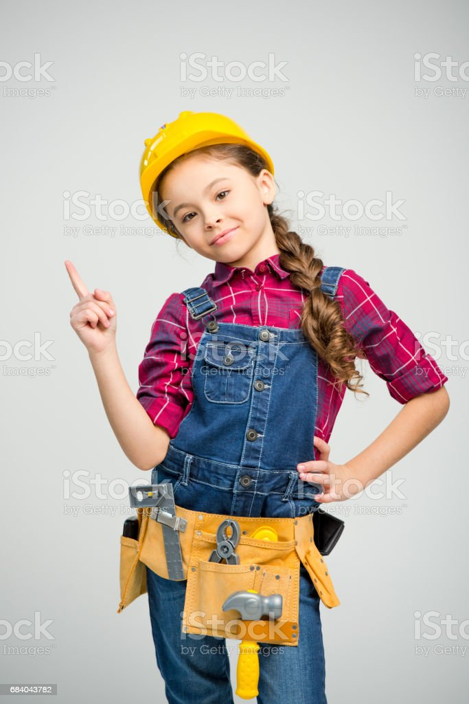 Little girl in tool belt stock photo
