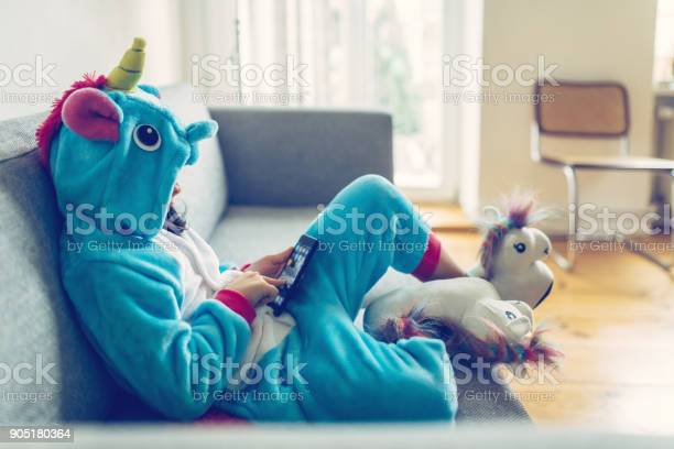 Little girl in unicorn costume with mobile on couch picture id905180364?b=1&k=6&m=905180364&s=612x612&h=ddjzjumbqjpefhv5wbwkhpltrlj8urh28pre7qqw3qs=