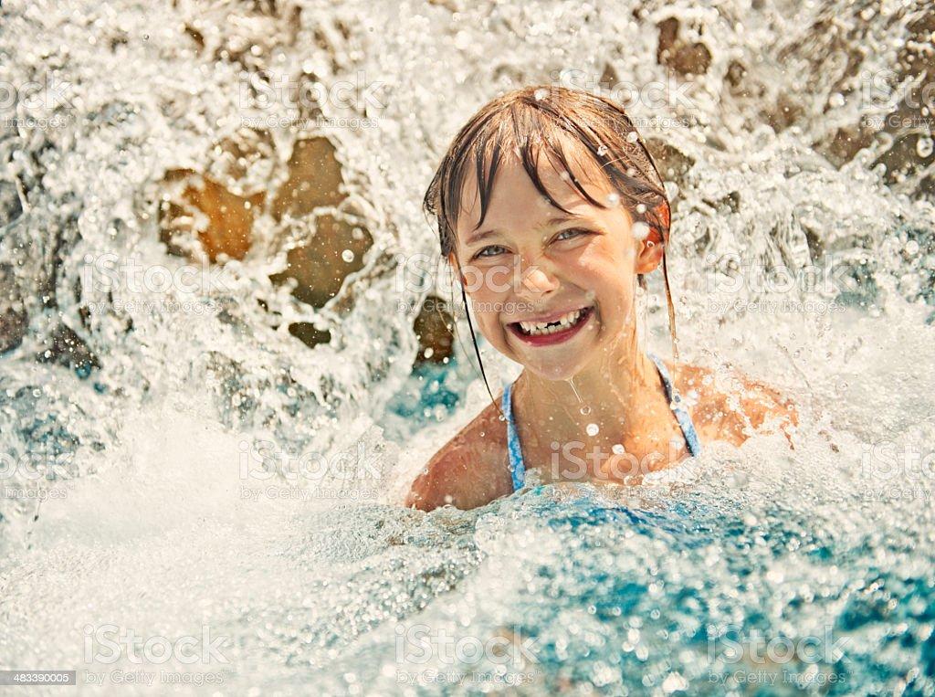 Little girl in water park stock photo