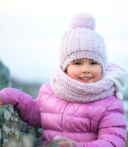Little girl in winter season with red cheeks stock photo