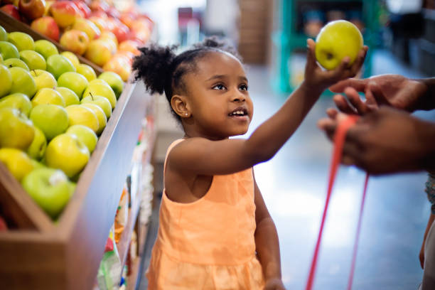 Little girl in zero waste oriented fruit and grocery store. stock photo