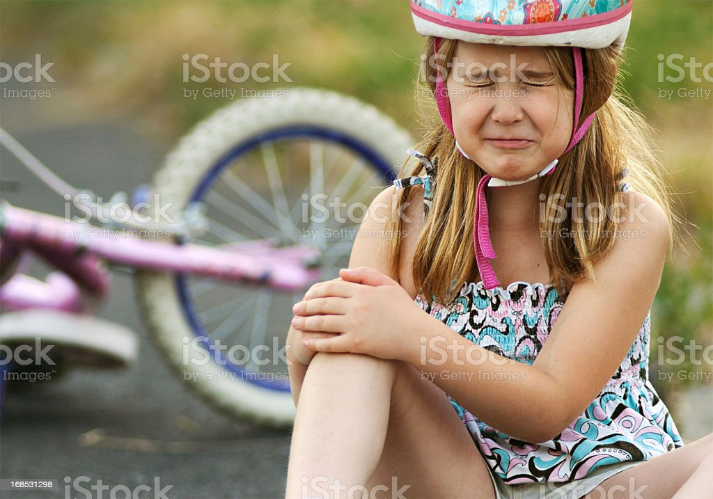 Little girl injured from bicycle crash stock photo