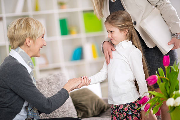 Little  girl introduction her new babysitter stock photo